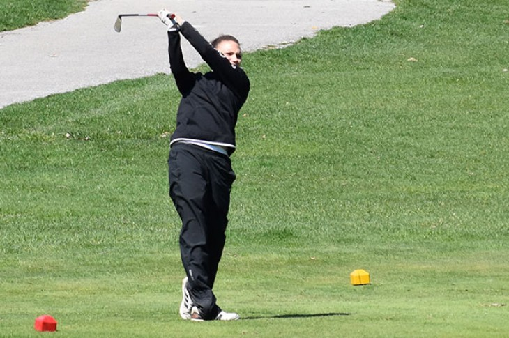 Emily Bell drives off the tee at Lincoln Oaks.