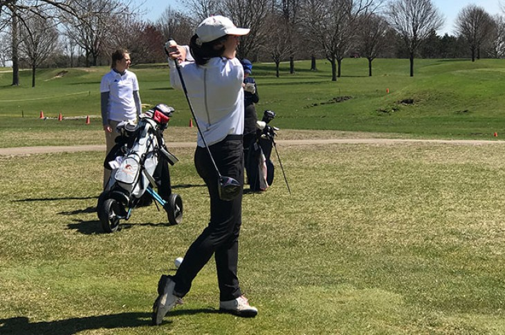 Nicole Brusich drives a shot off the tee.