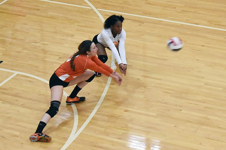 Erika Halverson (left) and Briana Holden close in on a dig