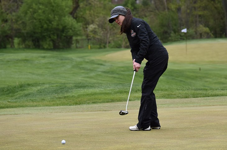 Megan Kirn takes aim on the green at Flossmoor CC.