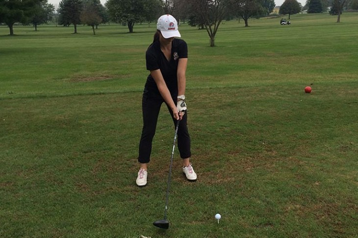 Nicole Brusich prepares to drive off the tee