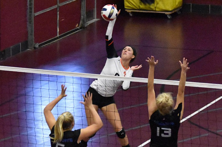 Erika Halverson finishes a spike against Culver-Stockton.