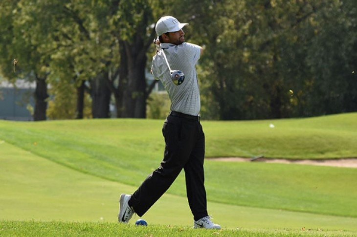 Matt Contey drives off the tee at the Calumet Country Club.