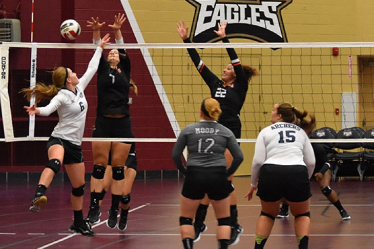 Milica Maras (left) and Hayley Serbin go up for a block against Moody Bible.