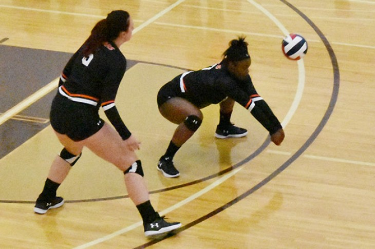 Malika Johnson gets low for a dig against the Fighting Saints